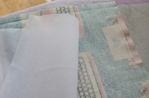 รีดผ้ากาวบนด้สนหลังของผ้าชิ้นนอก